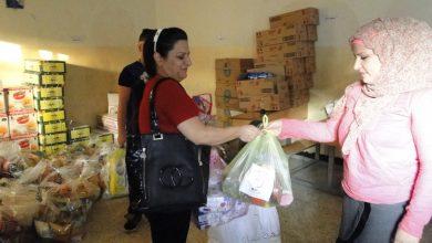 صورة متطوعون من جمعية نساء بغداد يساندون النازحين في كنائس بغداد